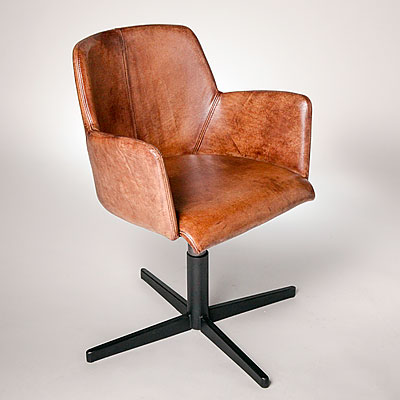 A LEATHER SWIVEL CHAIR