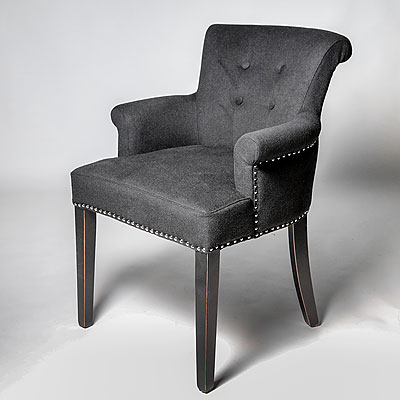 A BLACK CASHMERE ARM CHAIR