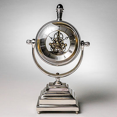 MAGNIFYING GLOBE CLOCK ON STAND
