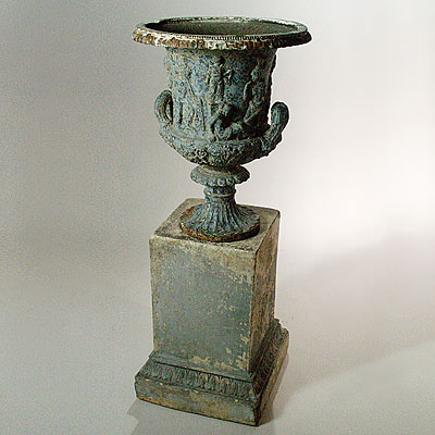 PAIR OF WEATHERED URNS
