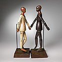 SET OF TWO ARTIST FIGURES